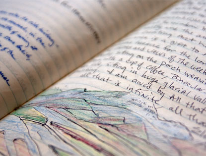 closeup of a journal with a sketch of mountains in it
