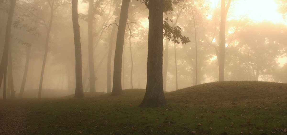 Prehistoric burial mounds on foggy morning