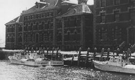 Coast Guard boats in front of the hospital complex c. 1952.