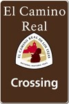 El Camino Real de los Tejas logo with a brown background, red-shaded missions, a winding trail, and a silhouette of a person.