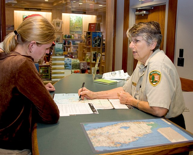 Volunteer and visitor looking at a park map