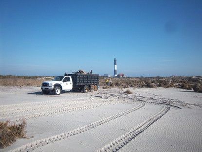 Flattened dunes and debris removal at Fire Island Lighthouse in November 2012.