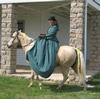 Woman riding Sidesaddle on Horseback