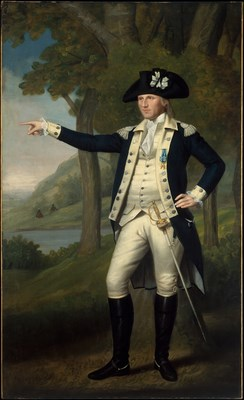 A man in a fine thick wool blue and light yellow jacket points off into the distance, his other arm on the hilt of his sword