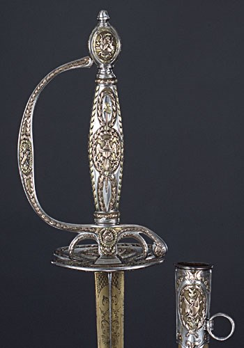 a fine sword hilt with decoration, the same is in the painting above.