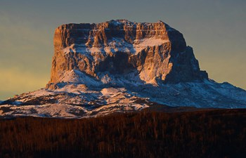 Chief Mountain with a dusting of snow at sunset.