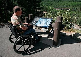 man with wheelchair at wayside exhibit