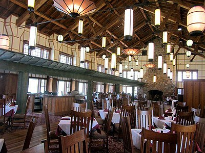 Hotel dining room with exposed beams and Asian-style lanterns