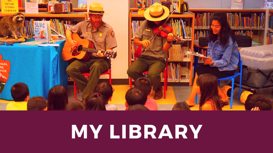 My Library image of rangers at a library playing musical instruments to children