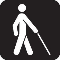 A silhouette of a person walking with a cane