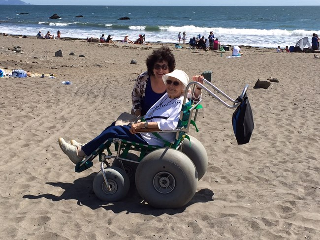 Image of women in a beach wheelchair at Muir Beach