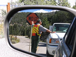 Maintenance worker holds traffic.
