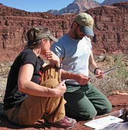 2 archeologists working at the Unkar Delta Site.