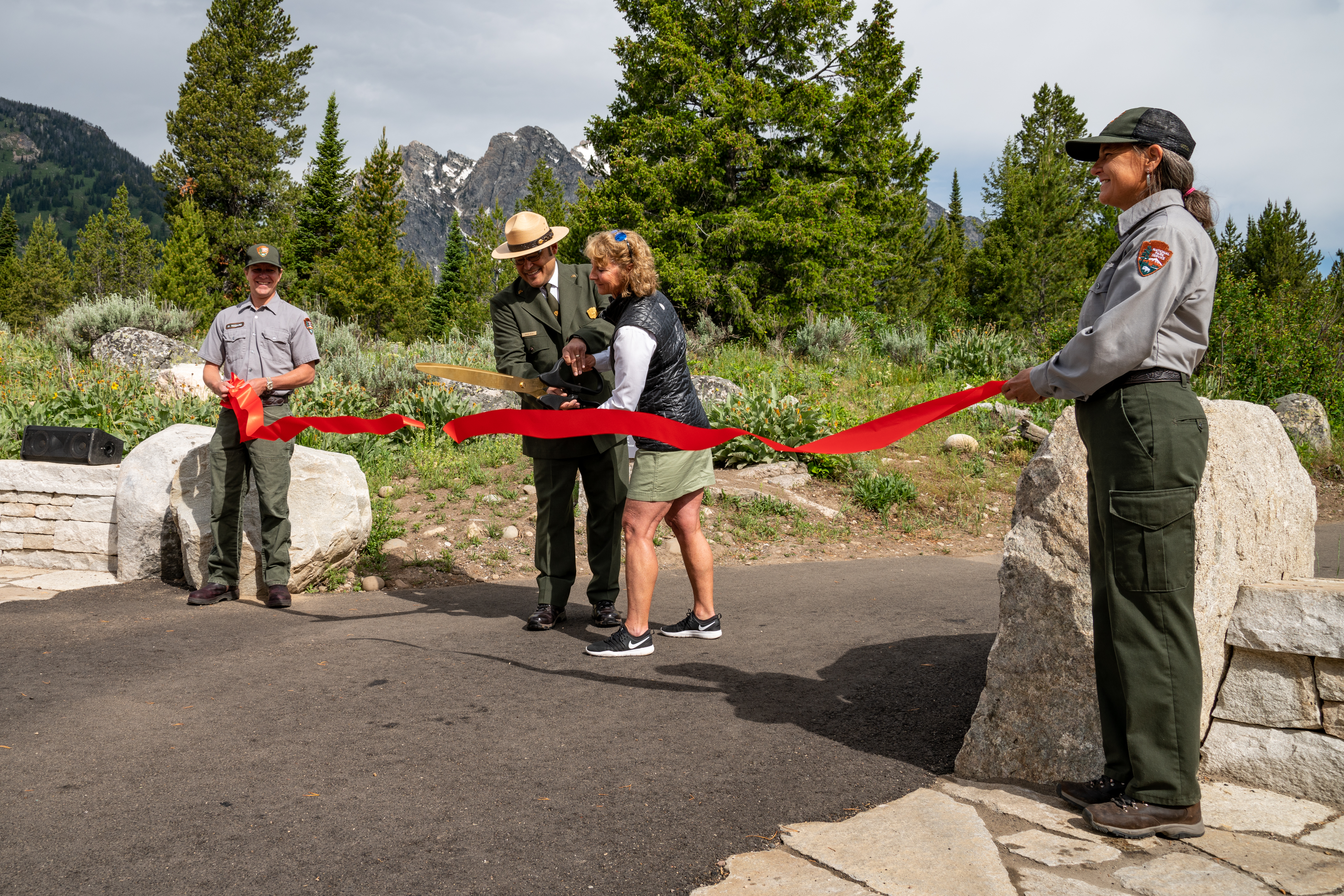 Acting Deputy Director of Operations for the National Park Service David Vela and Grand Teton National Park Foundation President Leslie Mattson cut the ribbon at the Jenny Lake Renewal Project