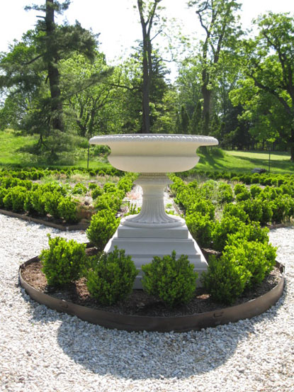 Reproduction urn placed in historic falling garden at Hampton NHS.