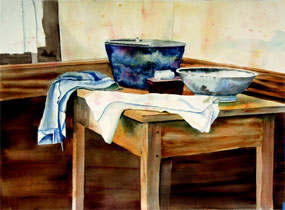 Watercolor painting of two washing bowls and a bar of white soap on a tray, plus two cloths on a wooden table near a window.