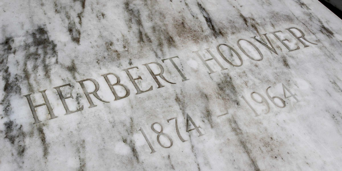 A marble ledger stone bears the inscription Herbert Hoover 1874-1964.