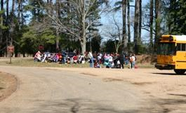 Students eating lunch at the picnic tables next to the Bus parking area at Historic Jamestown