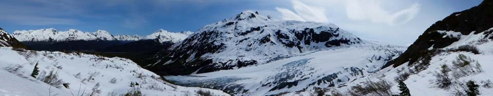 Panorama of Exit Glacier with mountains in the background.