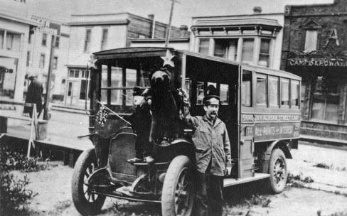 Black and white historic photo of Martin Itjen standing in front of his streetcar.