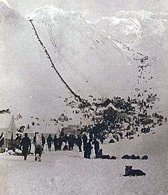 Historic photo of people preparing to hike over Chilkoot Pass.