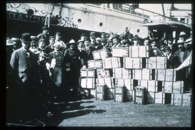 Two tons of newly unloaded Klondike gold on the wharfs of Seattle