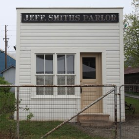 "Building with large sign reading ""Jeff. Smiths Parlor"""