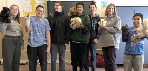 "Students from ""The Ranger Report"" pose with bear puppets and skulls"