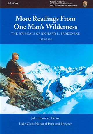 book cover showing a man sitting on rocks amid snowy mountains