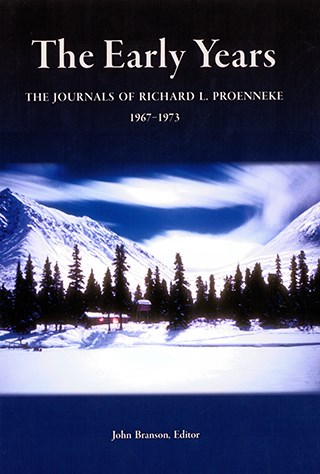 book cover showing snowy forest and mountain landscape