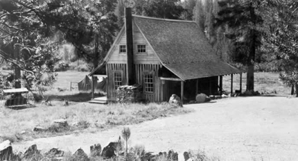 black and white photo of rustic cabin in 1931