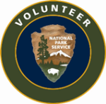 A National Park Service arrowhead with the words volunteer written above it.