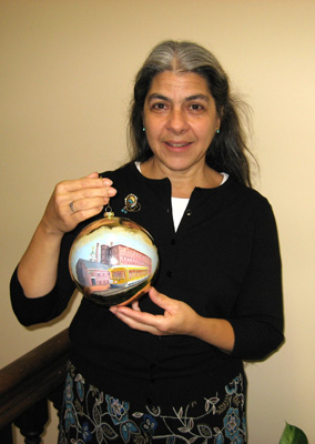 Park employee Ellen Frost holds the holiday ornament she created for the White House