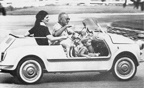 President Johnson takes daughter Luci and grandson Lyndon Nugent for a drive