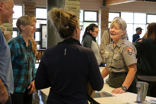 A park ranger answering visitor questions.