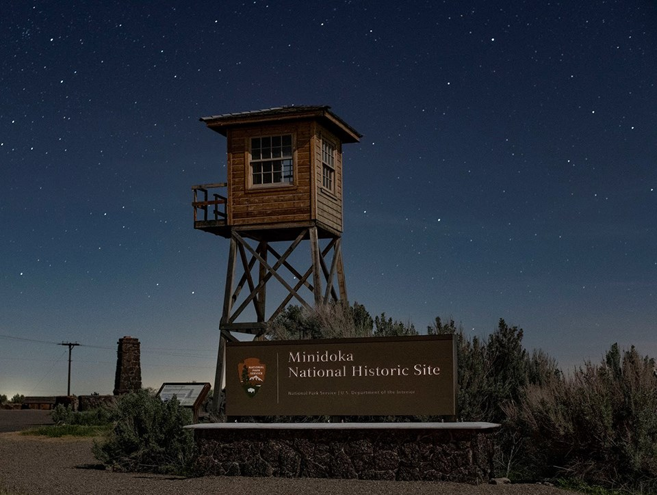 Guard tower and Minidoka sign at the entrance of the site