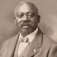 Sepia portrait of William Carney with his Medal of Honor.