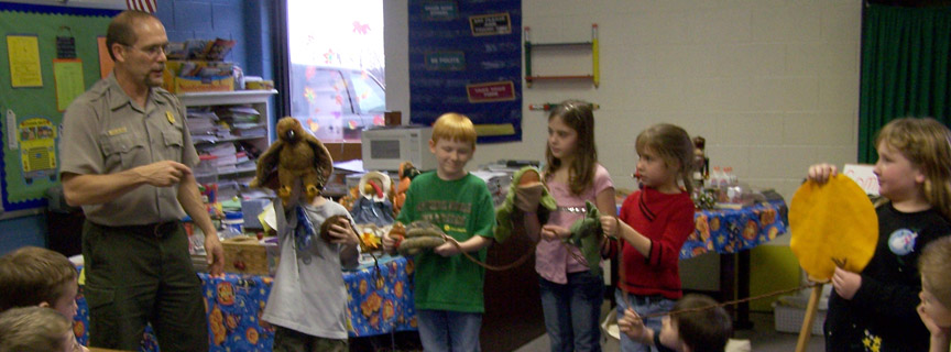 ranger and students demonstrating a food chain