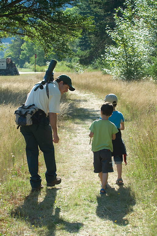 Young visitors join a birdwatching expert on a morning walk. Image Source: NPS/NOCA/David Snyder