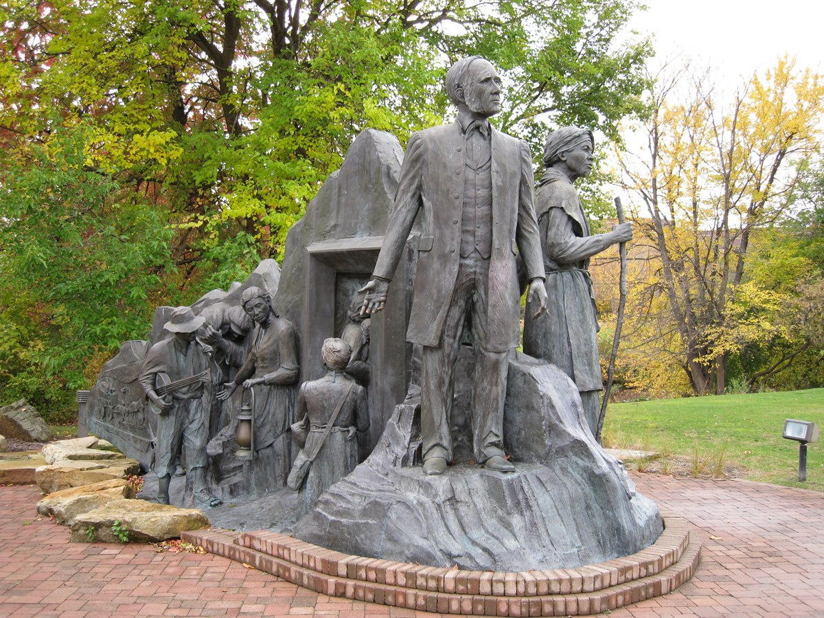 A bronze sculpture of Harriet Tubman and other Underground Railroad operators.