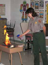 Ranger demonstrates forest fire behavior in a classroom