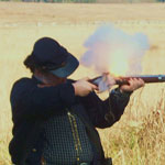 Ranger Firing a Musket During a Program for a school group.
