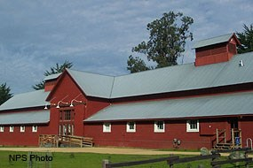 Red Barn exterior with cupola and trees
