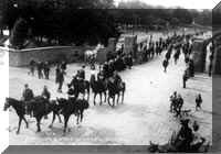 The 51st Iowa Volunteer Infantry Regiment passes through the Lombard Gate on the way to the Philippines.