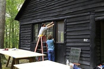 Volunteers working on a historic cabin