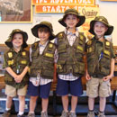 Kids with Junior Ranger vests smile