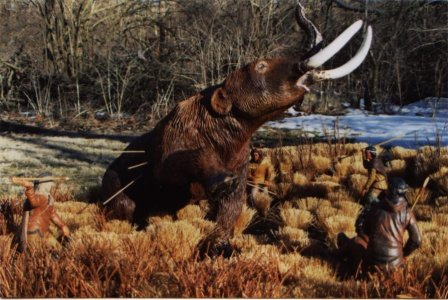 Native Americans hunting a Mastodon