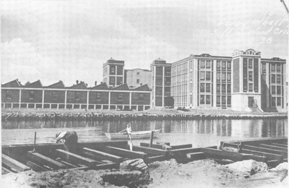 photograph of a huge mill complex, with buildings ranging from one to three stories in height.
