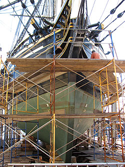 Friendship up on a drydock, surrounded by scaffolding.