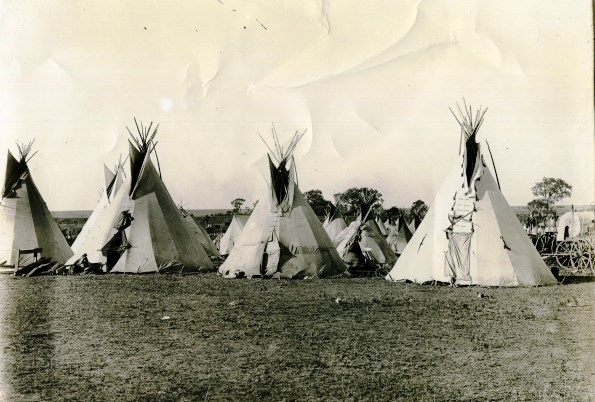 Historic Cheyenne camp with several lodges.